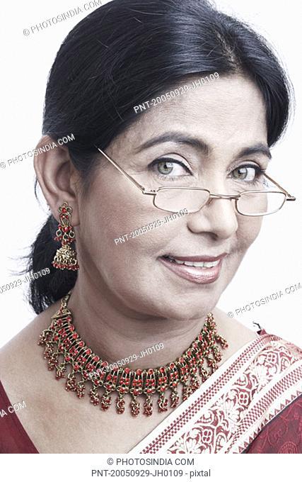 Portrait of a mature woman peeking over an eyeglasses