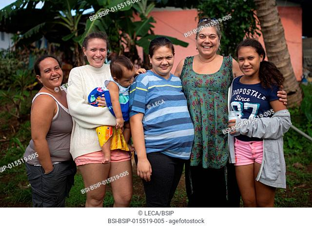 Reportage on a mainland French couple having recourse to a fa'a'amu adoption in Tahiti. Meeting the biological family before Léa's birth