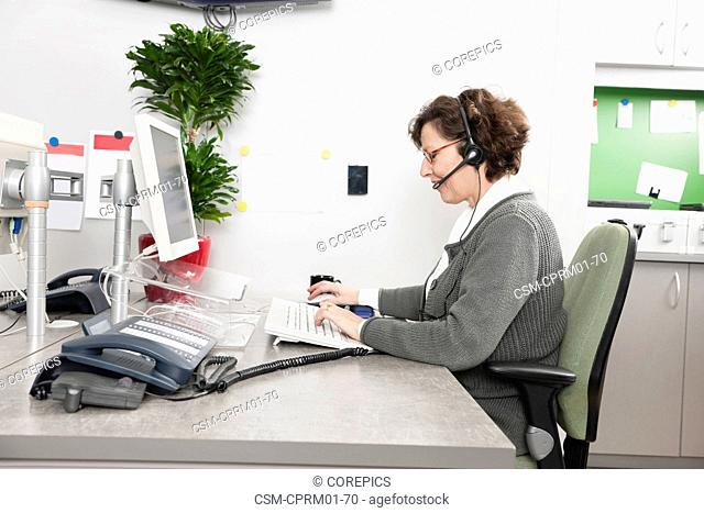 Older helpdesk employee, scheduling appointments for patients at a hospital's call center