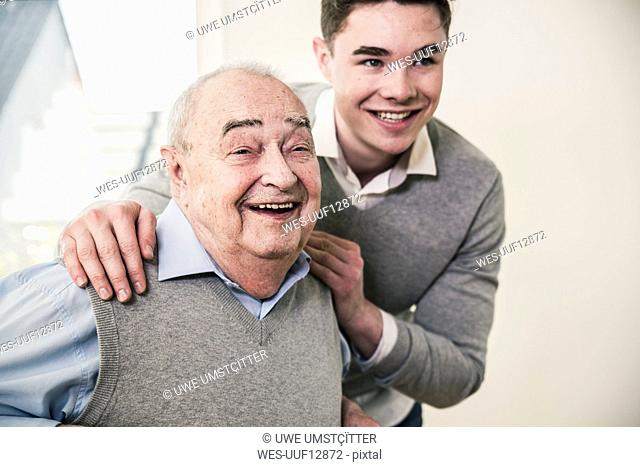 Portrait of happy senior man and young man