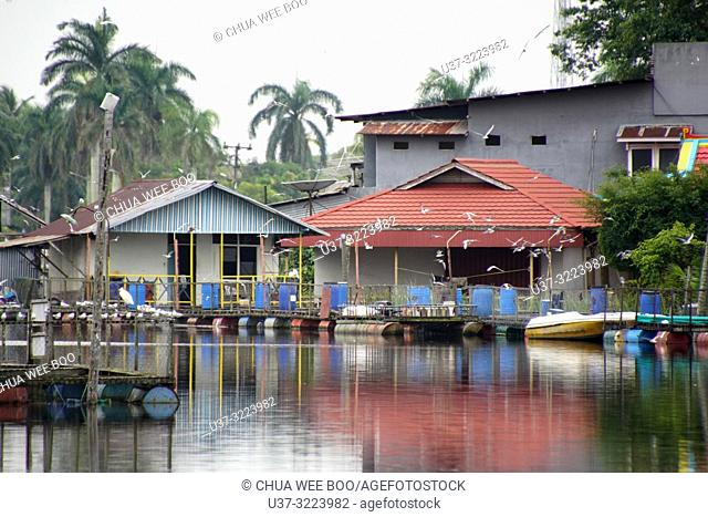 Shophouses by the riverbank of Mempawah town, West Kalimantan, Indonesia