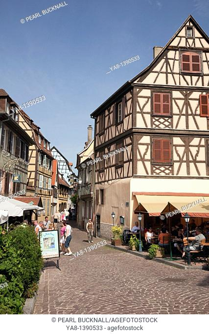Rue de la Poissonnerie, Little Venice, Colmar, Alsace, France, Europe / Historic buildings on narrow cobbled street in the Little Venice area of the old town...