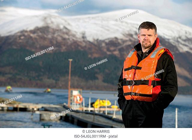 Worker smiling on salmon farm