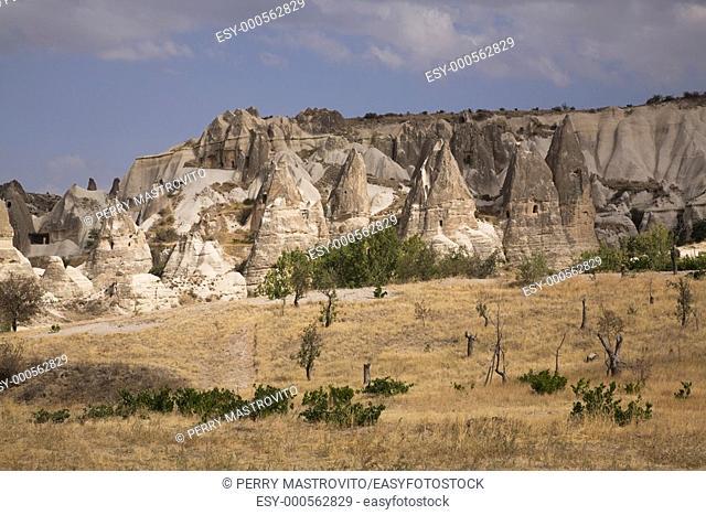 Rock-cut cave dwellings in the Valley of Love near Goreme, Cappadocia region, Turkey