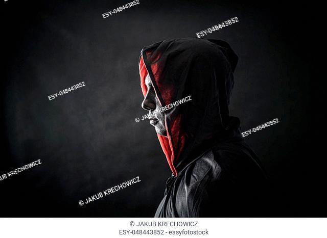 Hooded man in the dark