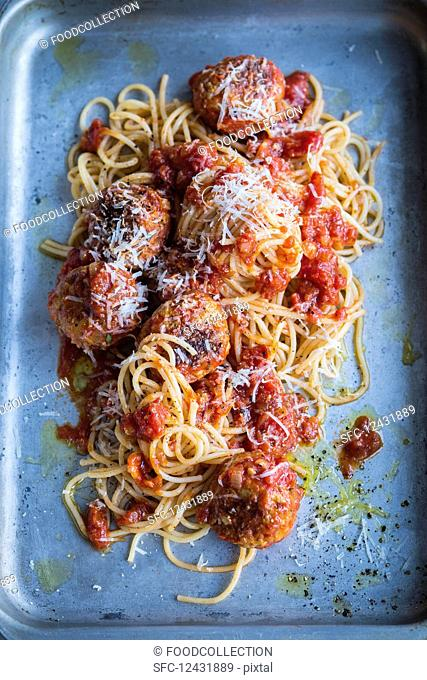 Spaghetti with meatballs on a baking sheet