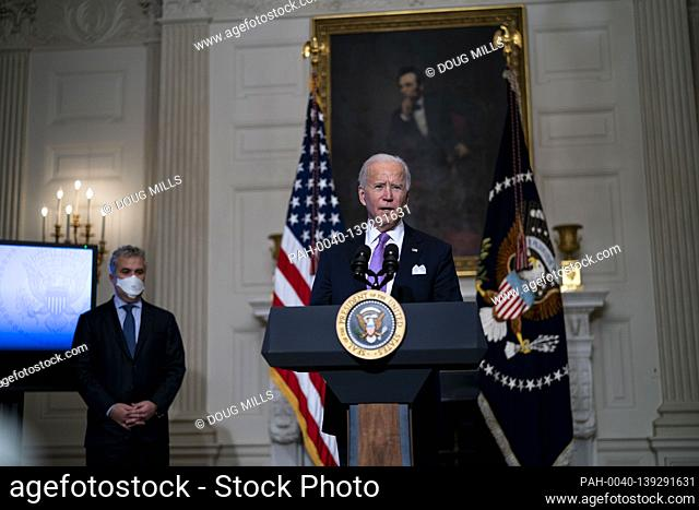 United States President Joe Biden delivers remarks on the fight to contain the COVID-19 pandemic in the State Dining Room of the White House, Tuesday