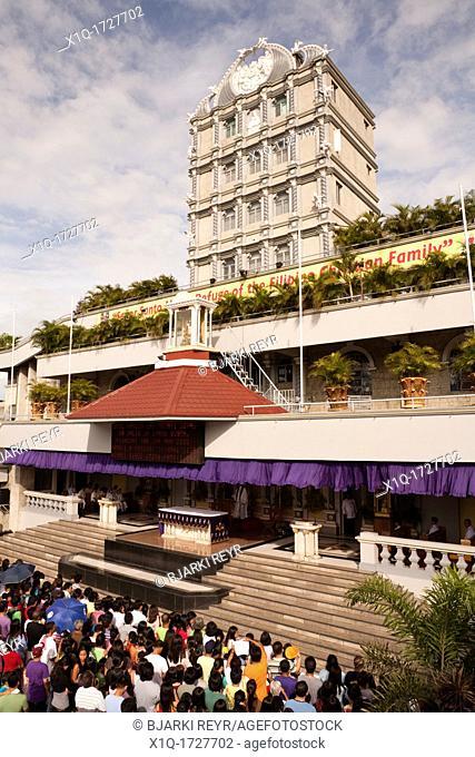 An outdoor Sunday mass at The Minor Basilica of the Santo Nino, aka Basilica Minore del Santo Nino, aka Basilica of Santo Nino  Cebu City, Cebu, Visayas