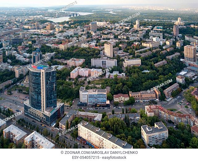 Aerial bird's eye view shooting from drone of central district of Kiev, Ukraine at summer sunset on the background of the cloudy sky