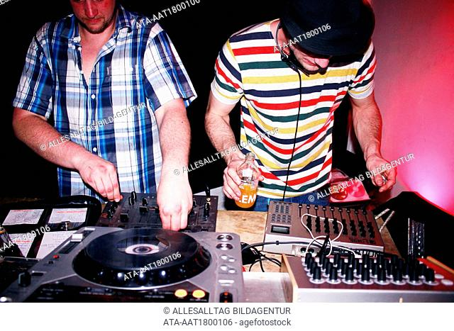 Two DJ??s at the record turntables