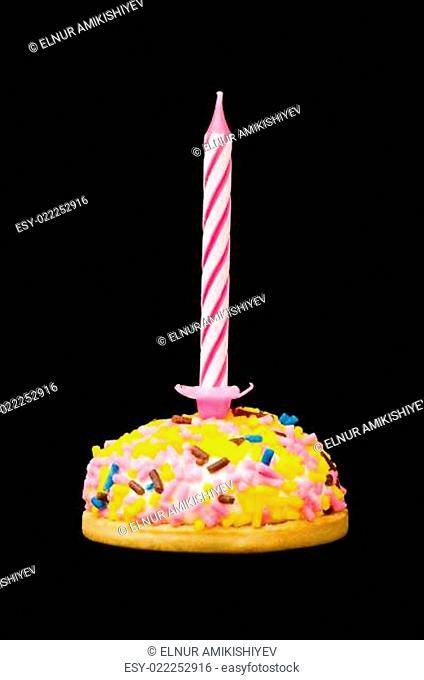 Cupcakes and candles isolated on the white background