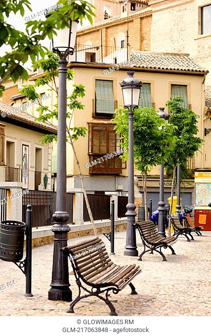 Benches in front of houses, Madrid, Spain