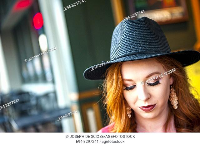 Portrait of a 25 year old redheaded woman in an urban setting
