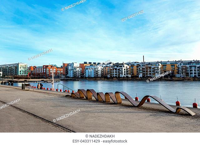 View of modern district in Stockholm Hammarby sjostad (Hammarby lake city) on sunny winter day. Waterfront colorful apartment buildings