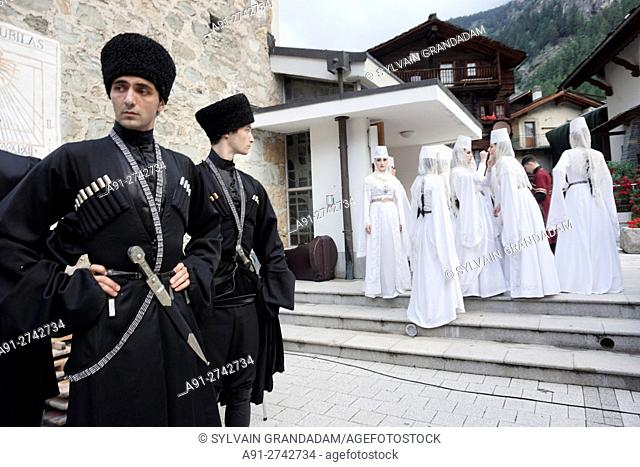 Switzerland, Valais, Val d'Herens, village of Evolene in summer during the first of august or national day, folk group from russian ossetia are performing