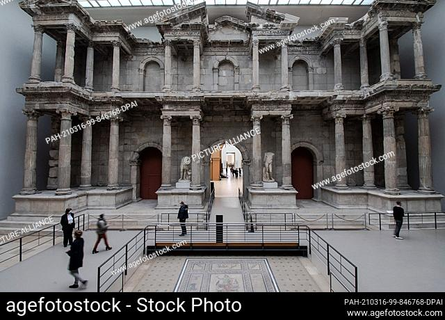 16 March 2021, Berlin: Visitors walk by the Market Gate of Miletus at the Pergamon Museum in Berlin. After the corona-induced lockdown