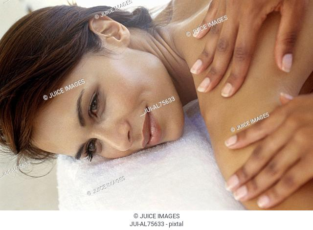 View of woman getting a massage and smiling