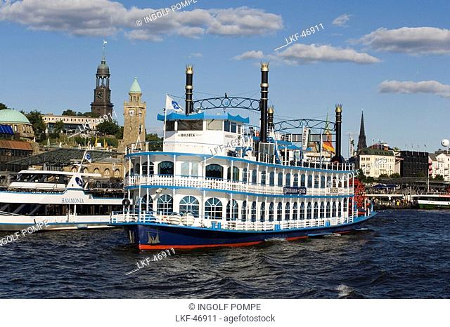 A paddlesteamer leaving the harbour, the steeple of St. Michaelis church in the background, Hamburg, Germany