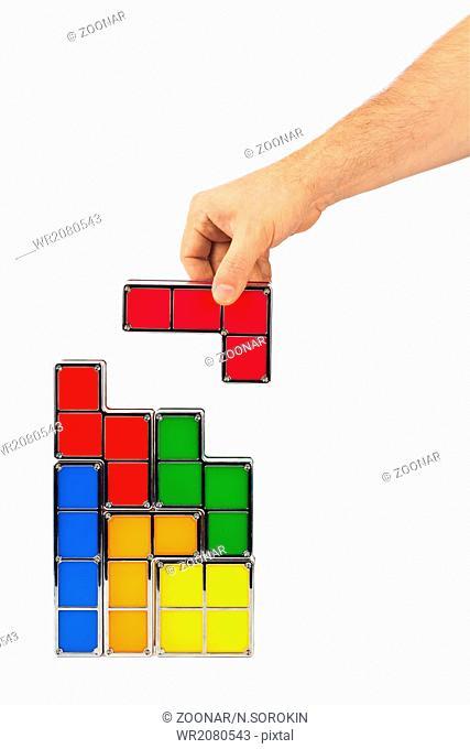 Hand with tetris toy blocks