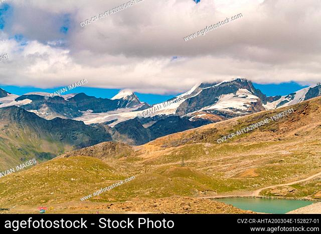 View from Gornergrat with lake and mountain Alps