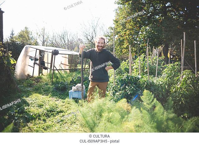 Young man in garden, portrait