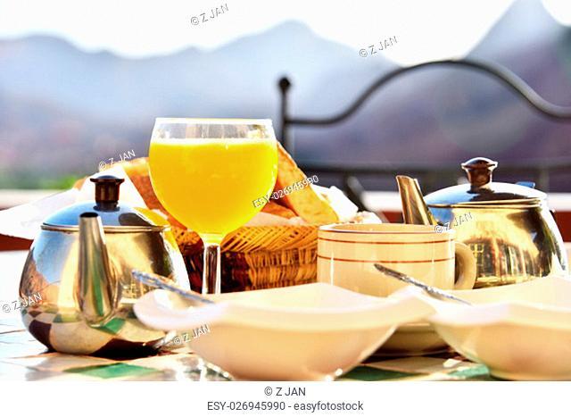 Moroccan breakfast served on hotel terrace in Atlas Mountains