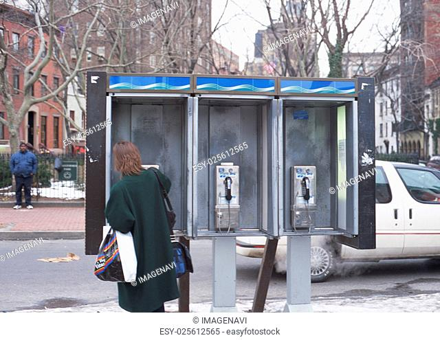 Public phone and a woman