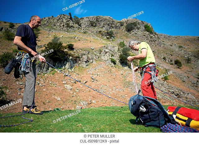 Rock climbers preparing climbing rope