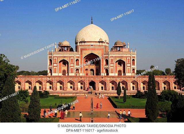 Tourists at Humayun's tomb built in 1570 made from red sandstone and white marble first garden-tomb on Indian subcontinent persian influence in mughal...