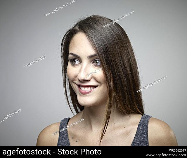Young woman looking away, smiling