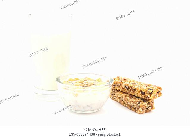 Glass of milk, corn flakes and cereal bars – healthy breakfast