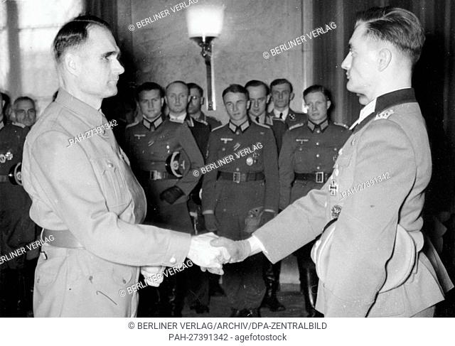 Reich Minister Rudolf Heß welcomes lieutenant and wearer of the Knights Cross, Herbert Berger, at the Führerbau in Munich