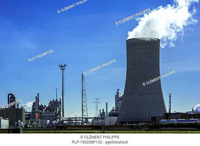 Industrial estate showing cooling tower of the BASF chemical production site in the port of Antwerp, Belgium