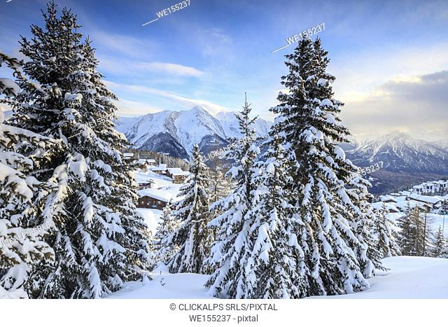 Snowy woods and mountain huts framed by the winter sunset Bettmeralp district of Raron canton of Valais Switzerland Europe