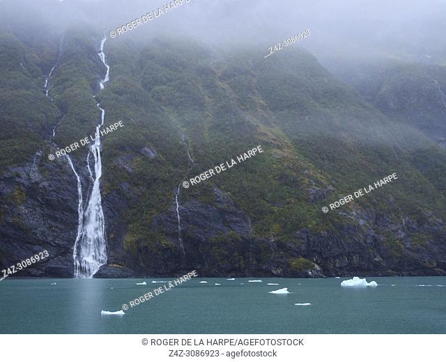 Waterfall near Surprise Glacier, Surprise Inlet, Harriman Fiord. Prince William Sound. Near Whittier. Alaska. United States of America