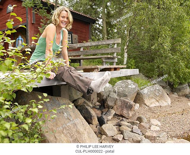 Woman sitting on dock smiling