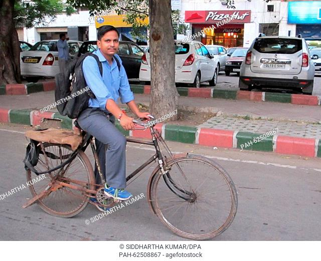 Dilip Kumar, an office peon in New Delhi, cycles around 30 kilometres to work and back everyday, negotiating the chaotic Delhi traffic, 1 September 2015