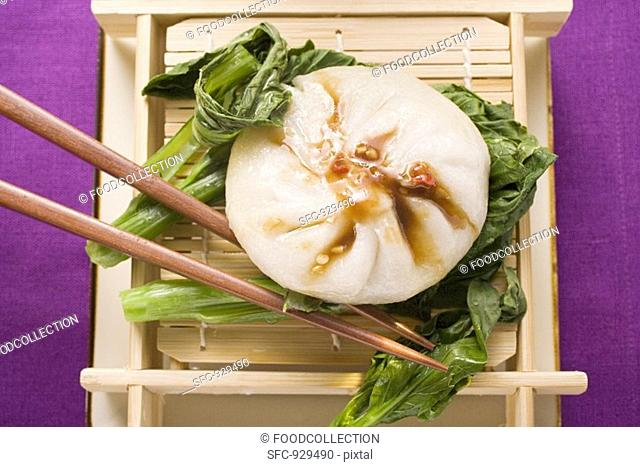 Filled yeast dumpling with Hoisin sauce on pak choi Thailand
