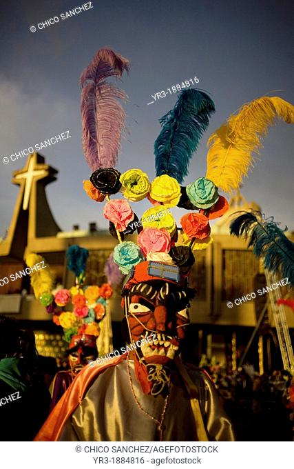 A pilgrim from Tomatlan, Veracruz state, dressed as a red devil performs the Baile de los Santiagos or Saint James's Dance outside of the Our Lady of Guadalupe...