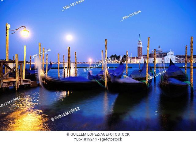 Gondolas moored at the St  Marks Basin waterfront, Venice, Italy