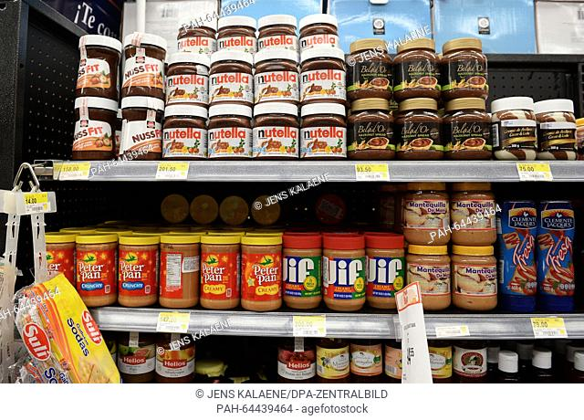 Nutella from Ferrero and NussFit from Schwartau can be seen on a shelf next to other sweet spreads in Managua, Nicragua, 28 November 2015
