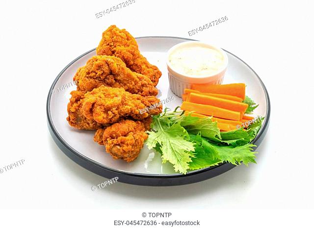 fried spicy chicken wings with vegetable isolated on white background