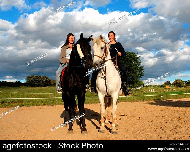training in dressage for a black horse and her riding girl