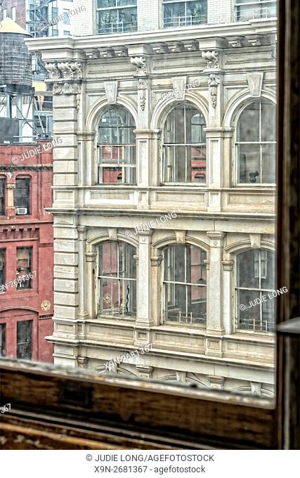 Looking at a Cast Iron Office Building Across the Street, from another Cast Iron Building Window. Flatiron District, Manhattan New York City
