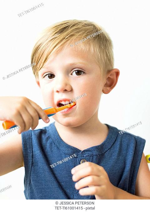 Little boy (2-3) brushing teeth