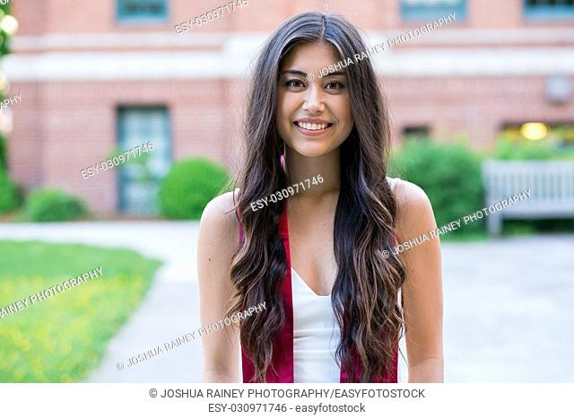 College senior picture of a graduating student on a university campus during the Spring in Oregon