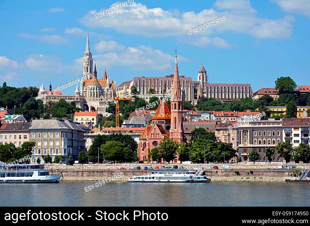 View across the river Danube to the historic buildings in Buda with Matyas church, Fishermen's Bastion and Calvin's church in Budapest - Hungary