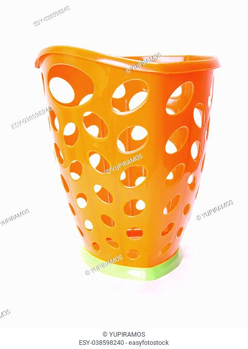 orange plastic trash can isolated, white background. photography
