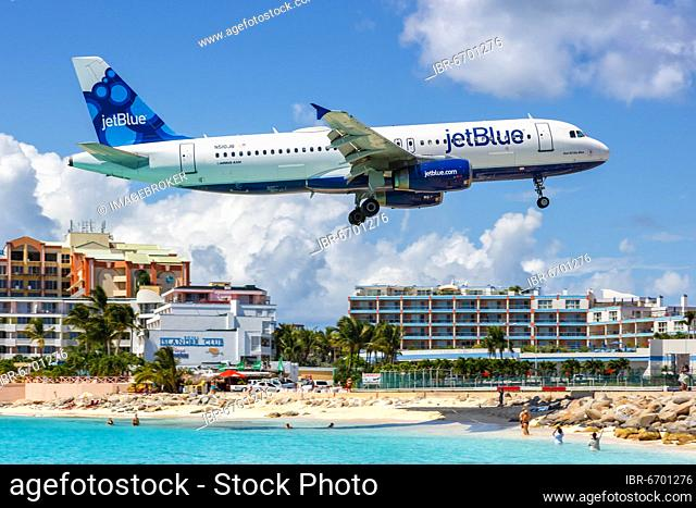 A JetBlue Airways Airbus A320 with registration N510JB lands at St. Maarten airport