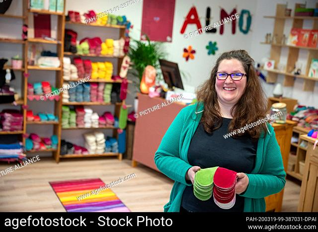 02 March 2020, Bavaria, Ansbach: Stefanie Wagner, owner of the menstrual shop, holds cloth bandages in her hands. A few months ago, the menstrual shop